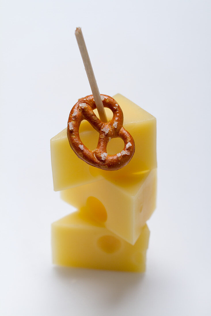 A Bavarian party skewer with emmental and a pretzel