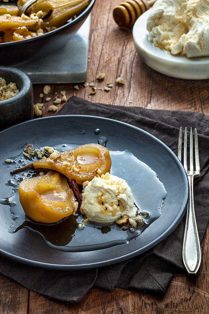 Roast pears with honey labne and candied hazelnuts