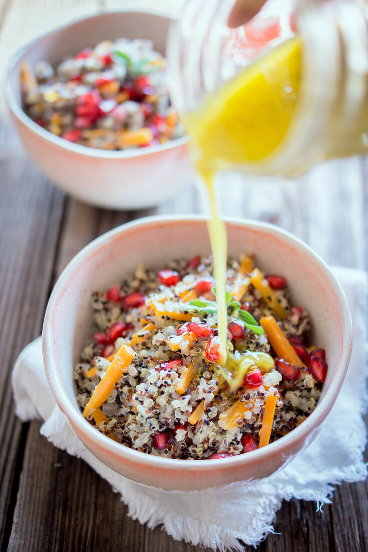 Quinoa bowl with a lemon and mustard dressing and pomegranate seeds