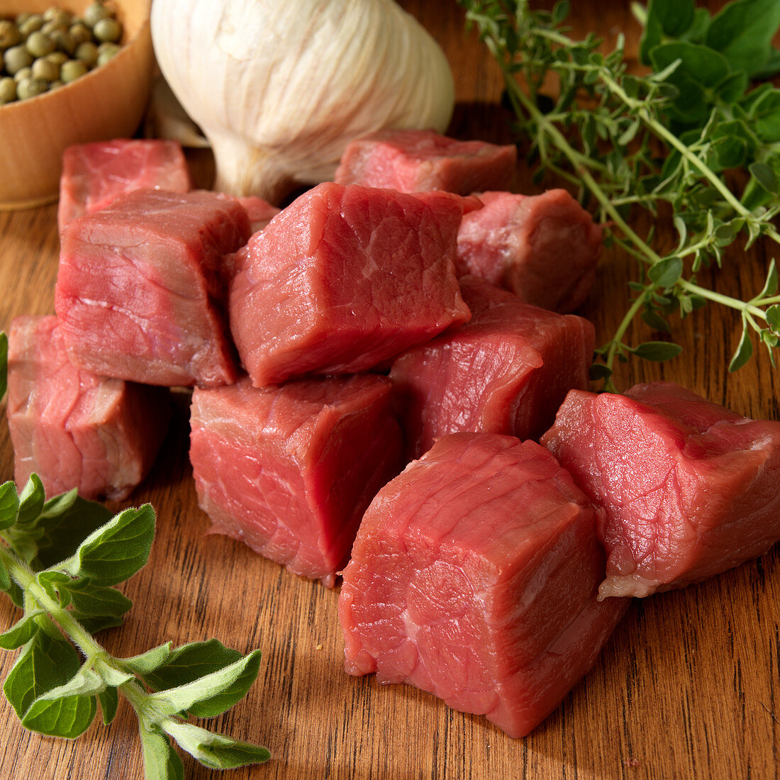 Raw beef cut into cubes with garlic and herbs