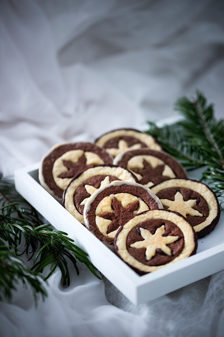 Vegan chocolate and vanilla biscuits, partially glazed with white rice milk chocolate and dark chocolate