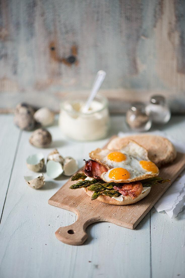 A bread roll with asparagus, bacon and quail's eggs