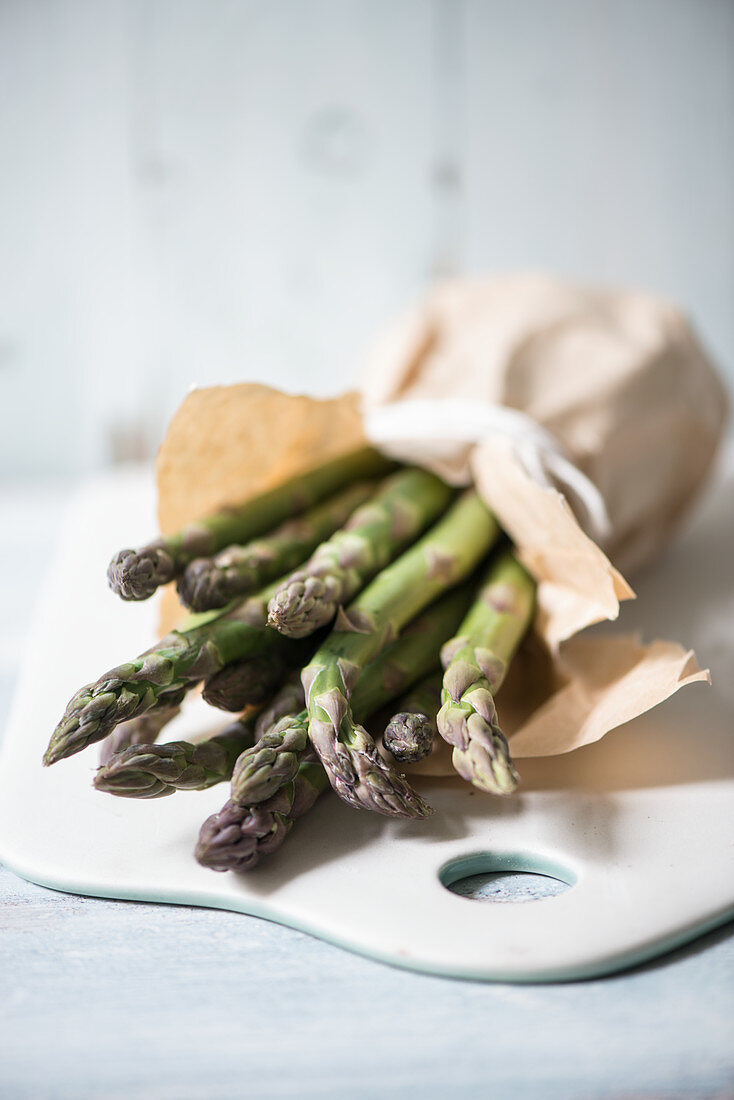 Green asparagus in a paper bag