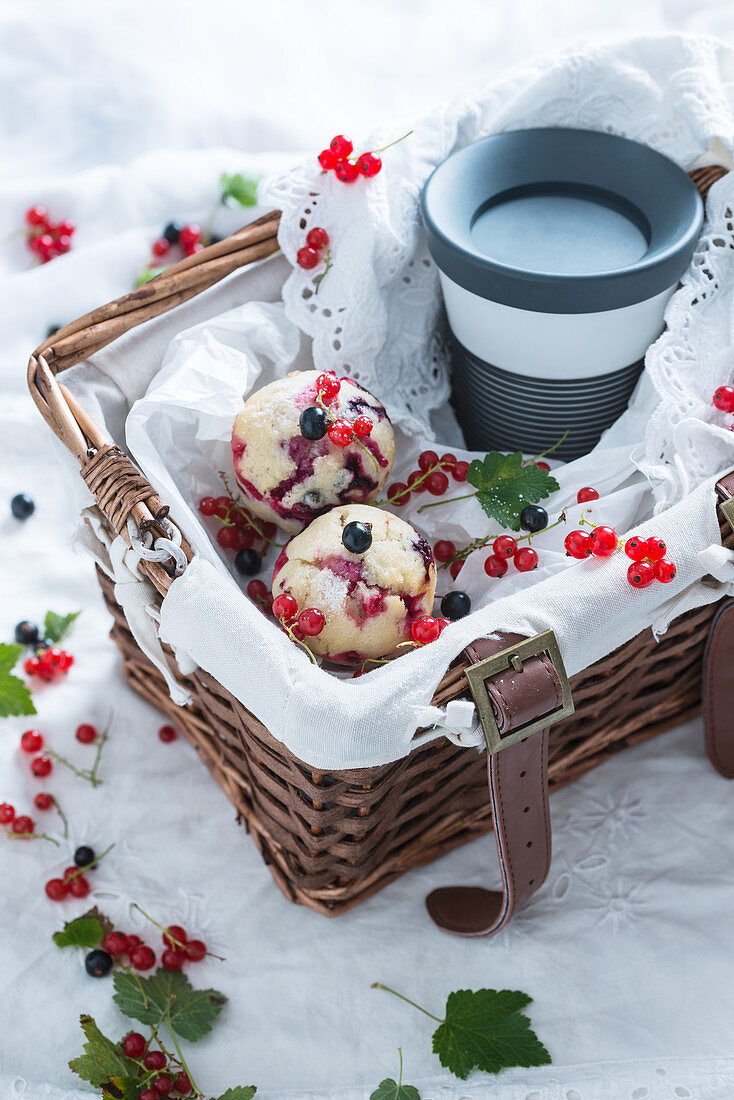 Vegan redcurrant muffins and coffee to go in a basket