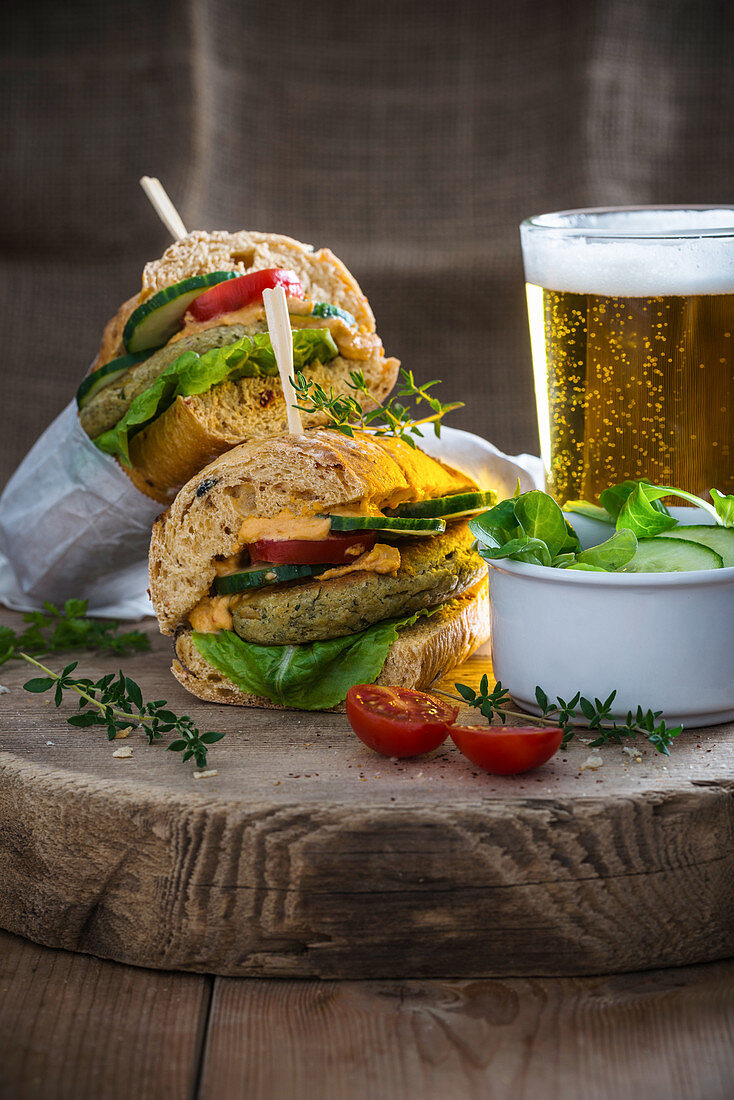 Vegan falafel sandwiches with chilli hummus served with beer