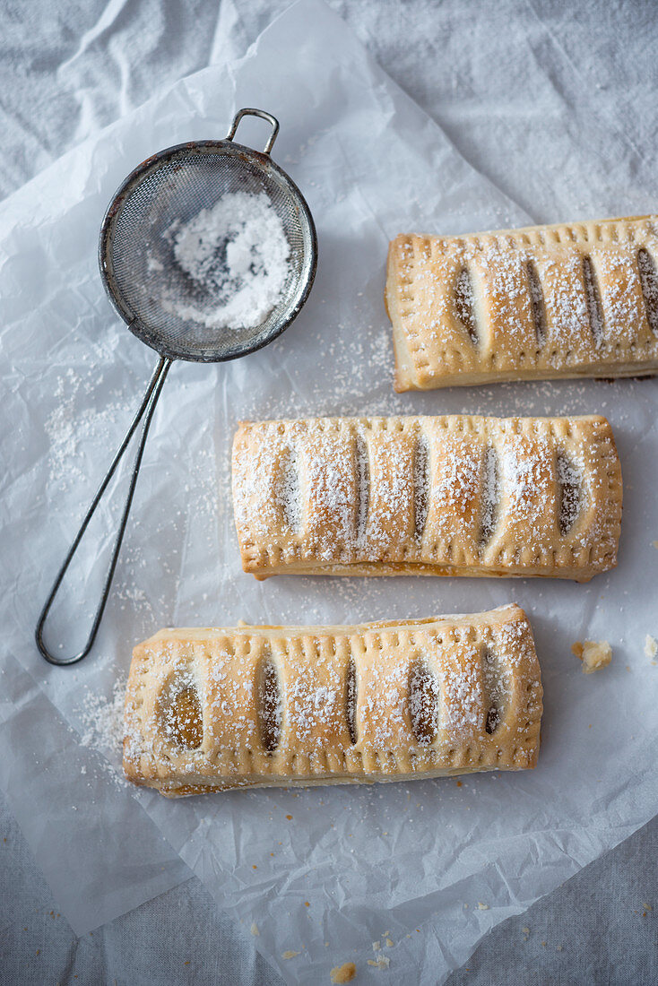 Vegan apple pies with icing sugar
