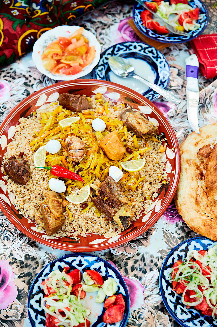Plov - Uzbekistan national dish with baked bread