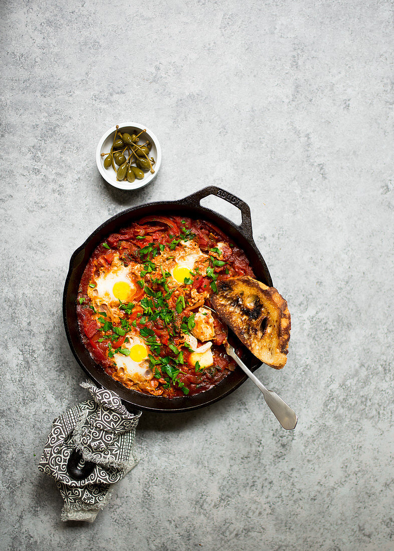 Shakshuka (poached eggs, North Africa) with harissa sauce