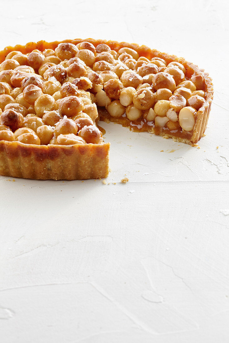 A macadamia tart with salted macadamia nuts, star anise and honey syrup