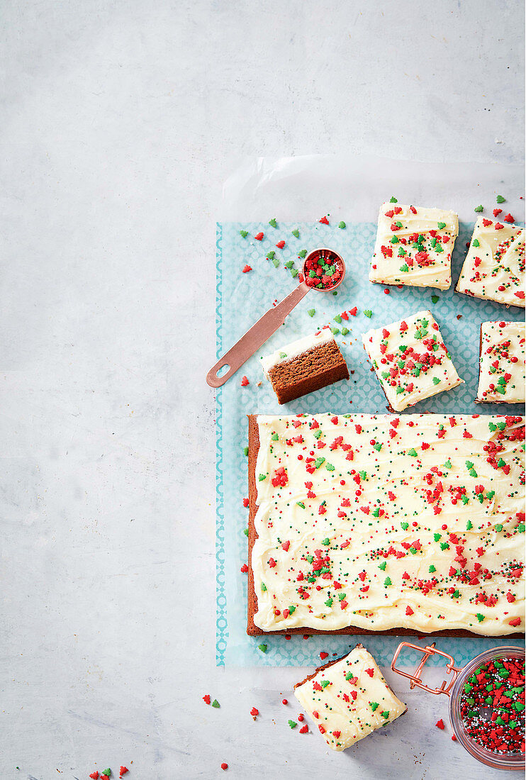 Spice cake tray bake with buttercream and sugar sprinkles