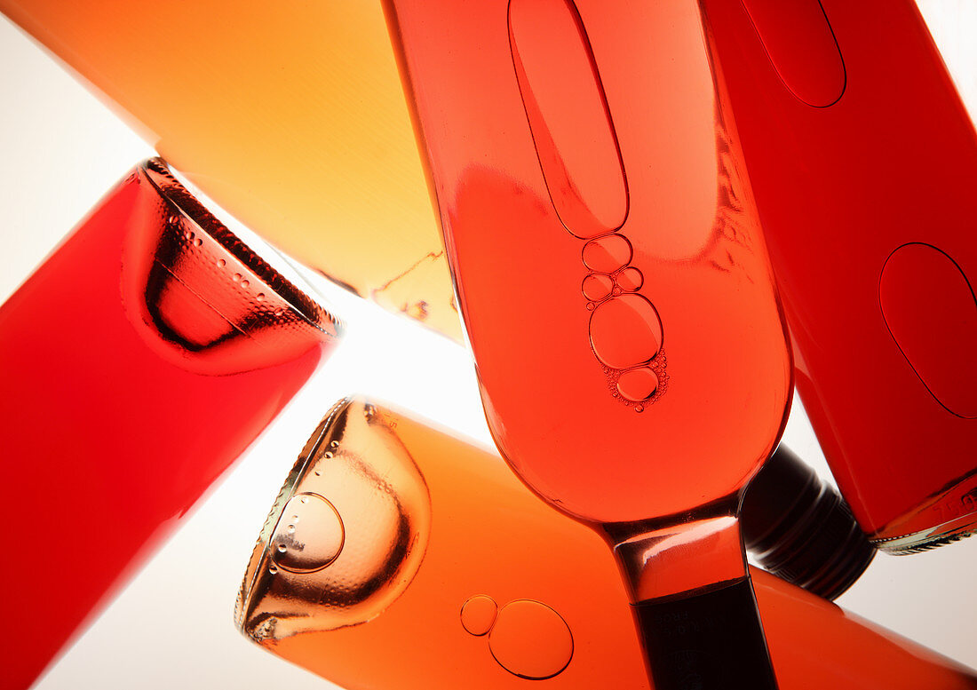 Various red wine and rose wine bottles (top view)