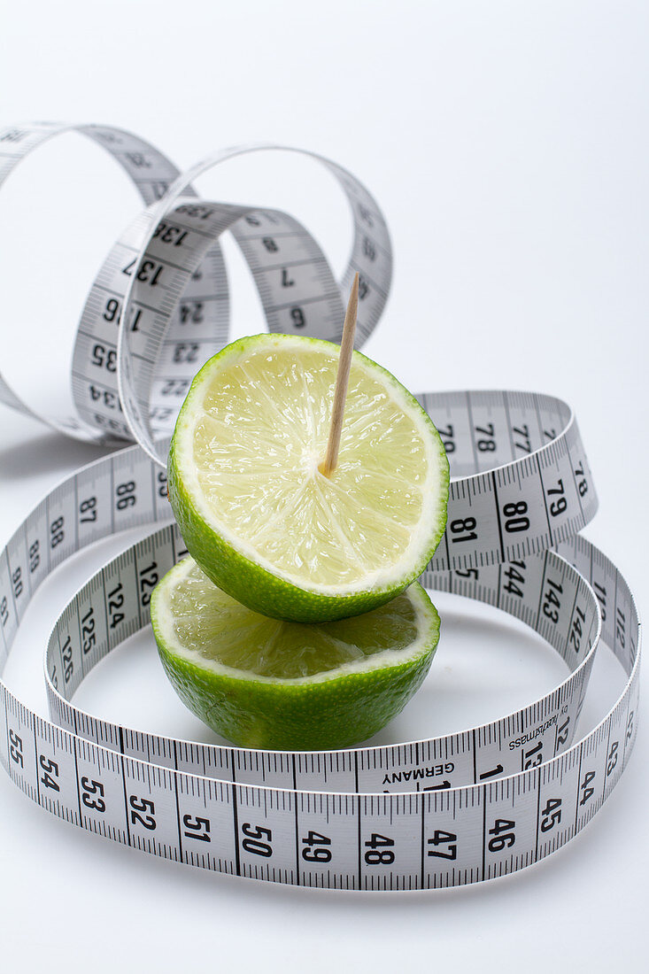 Lime halves with a toothpick and a measuring tape