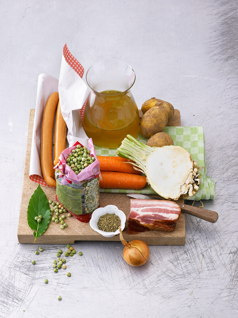 Ingredients for making pea soup on a chopping board