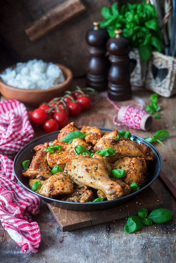 Roasted chicken bits with garlic and basil