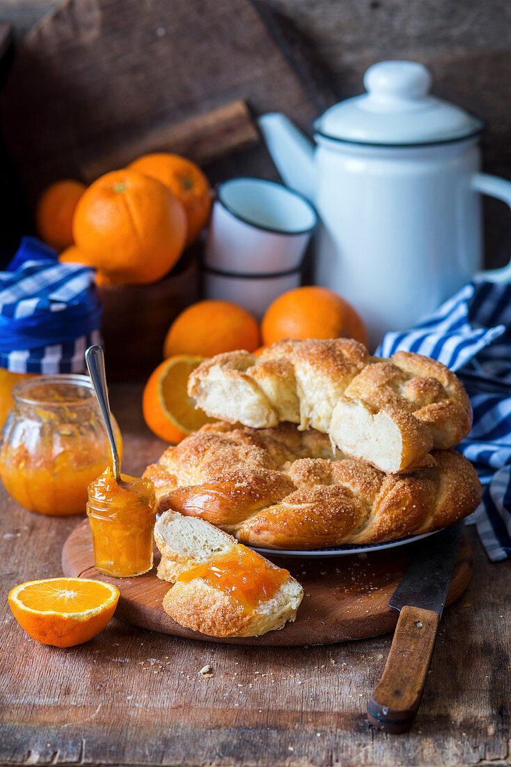 Homemade orange wreath bread with marmalade
