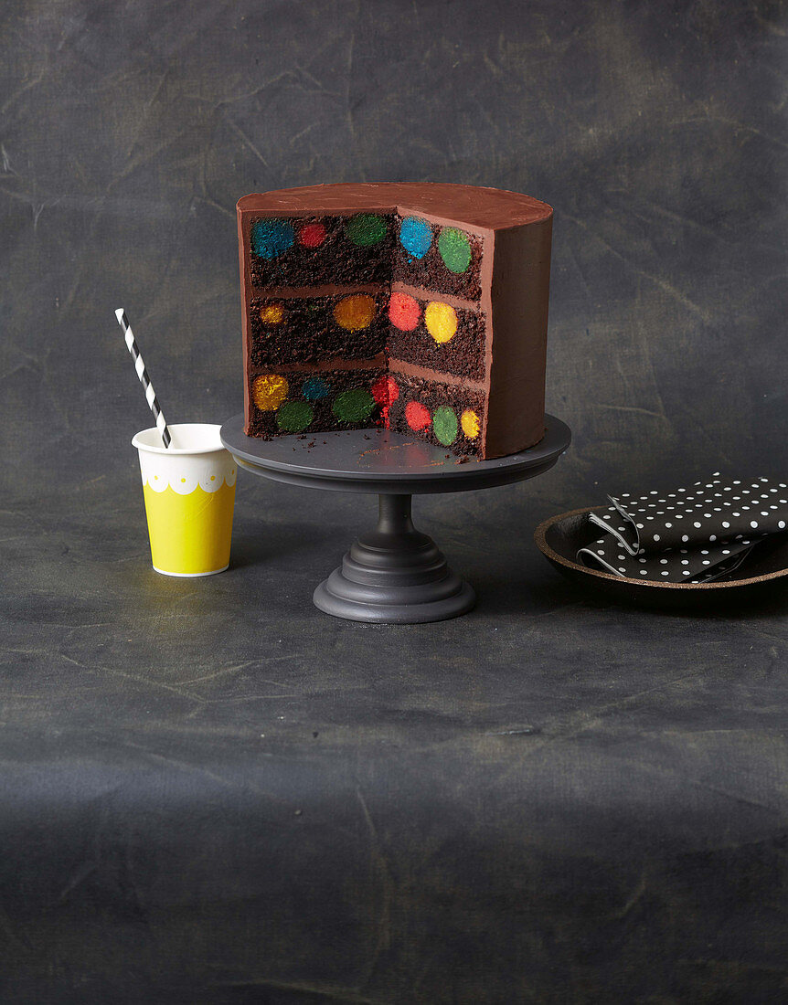 Devils Food Cake with polka dots on a cake stand, sliced