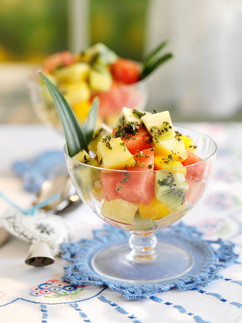 Tropical fruit salad with lime mint sugar