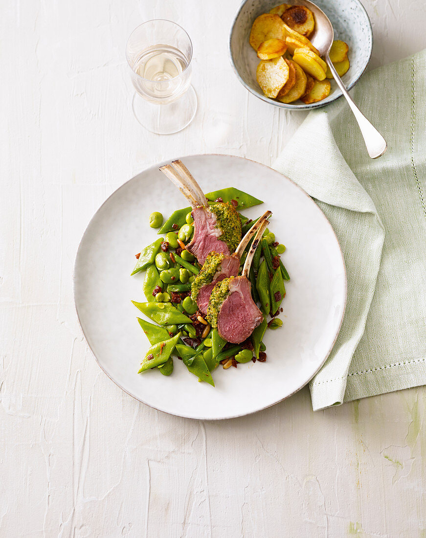 A rack of lamb with a herb crust and green beans