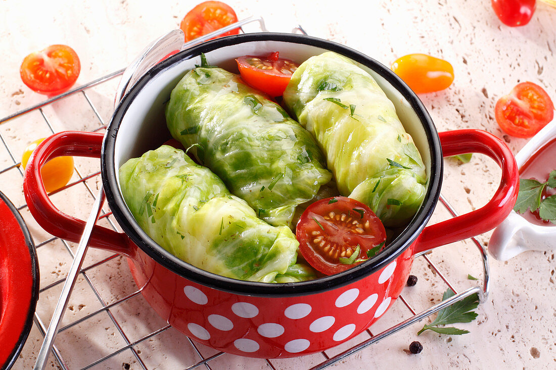 Green cabbage leaves stuffed with mince and rice