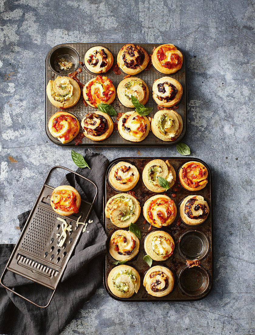 Ham, cheese and pineapple scrolls; Sun-dried tomato, olive and cheese scrolls; Cheesy vegemite scrolls; Pesto and fetta scrolls