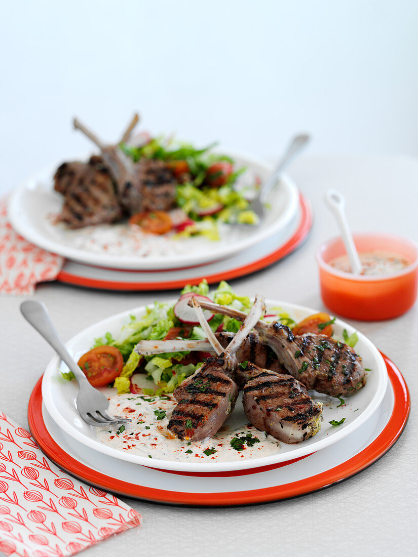 Grilled lamb chops with greek salad and tzatziki