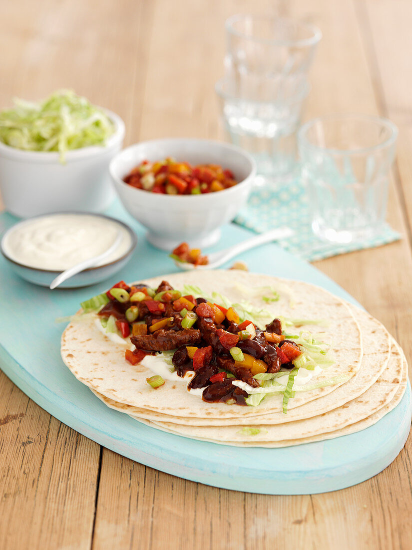 Mexican beef fajitas with sour cream