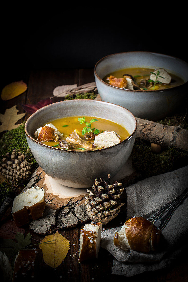 Bramboracka (Prague potato soup with lye croutons) on a wood slice