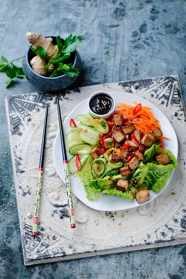 Oriental vegetables with tofu, chilli and sesame seeds