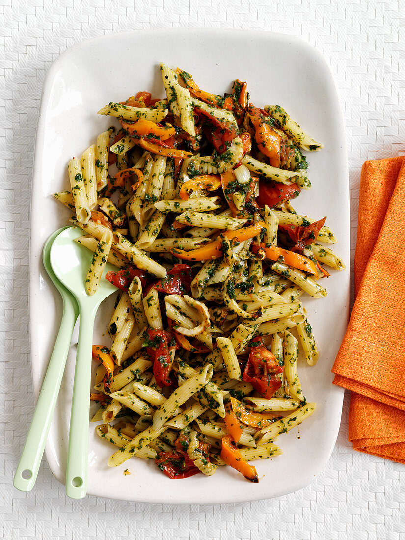 Penne with fried vegetables and basil sauce