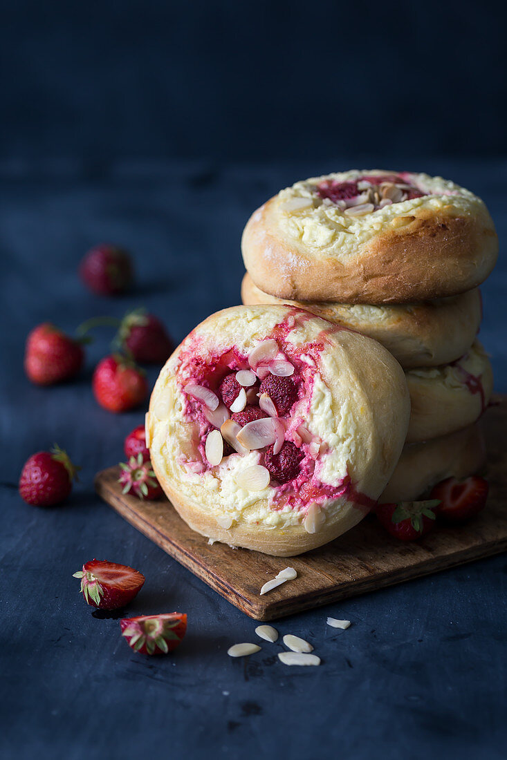Strawberry buns with cheese filling and almond flakes