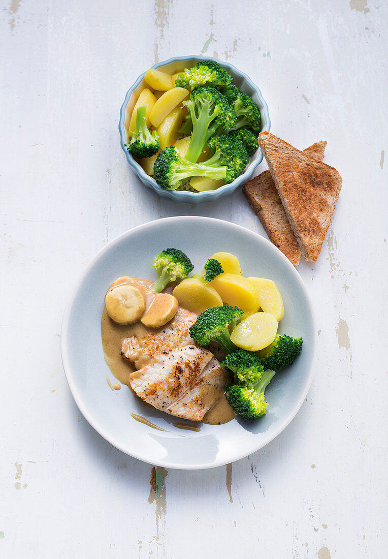 Rose fish in a mustard sauce with broccoli and potatoes