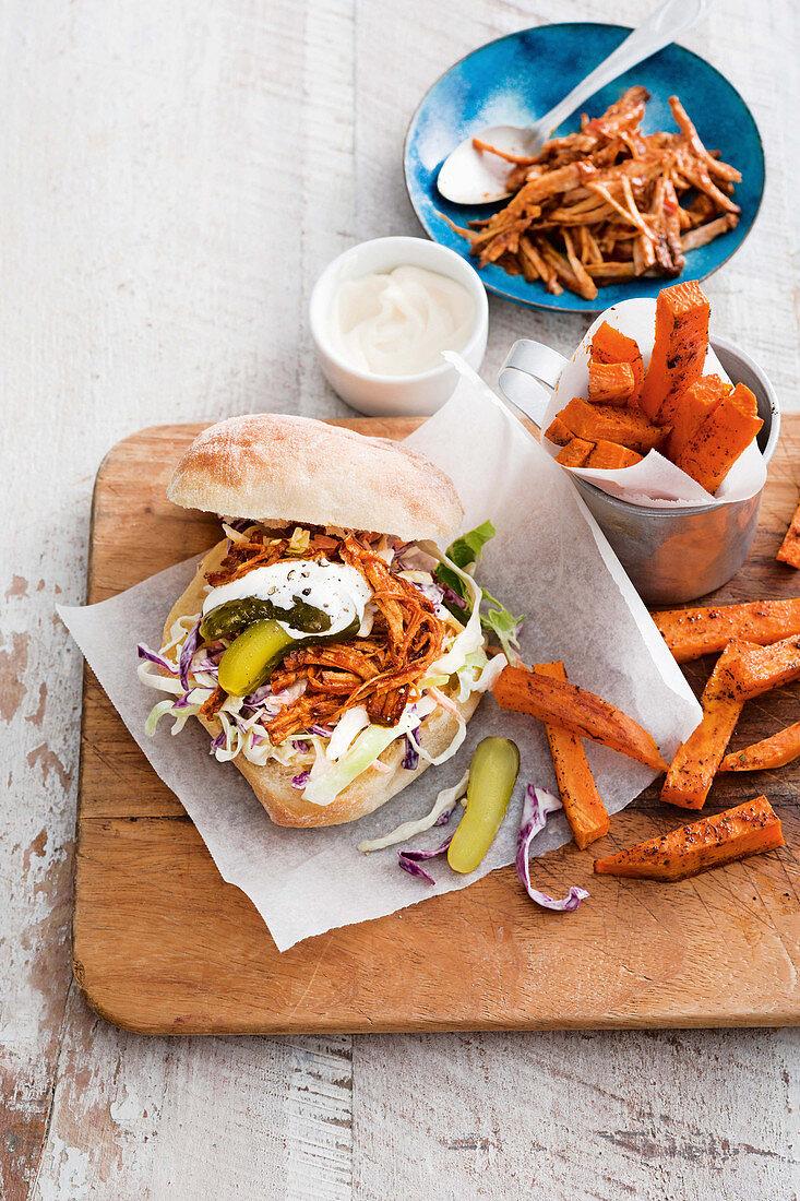 A pork sandwich and sweet potato fries