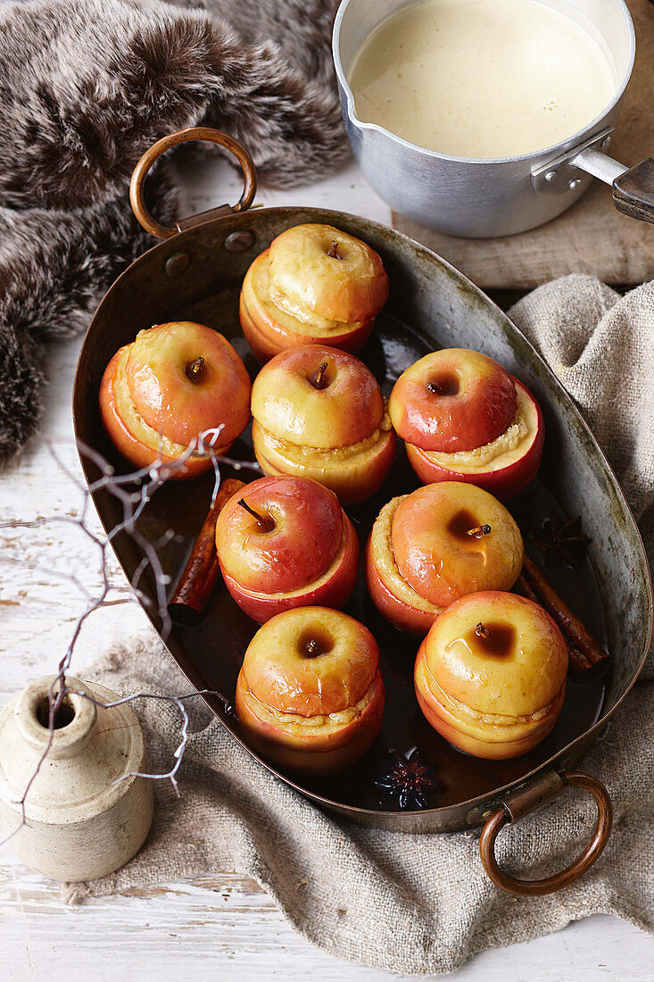 Baked apple puddings with white chocolate custard