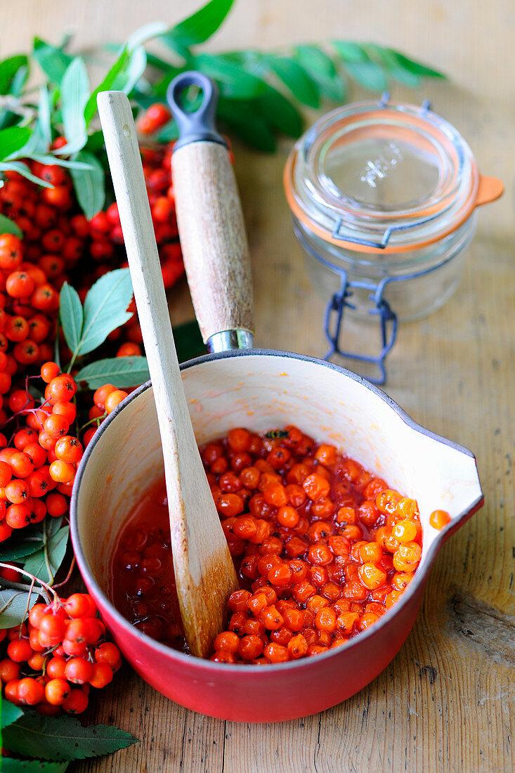 Rowan berry compote in a saucepan