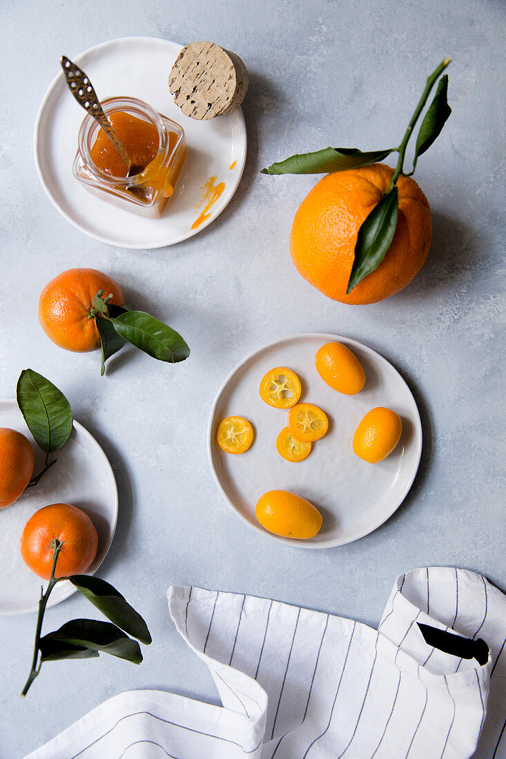 Citrus fruits and a jar of marmalade