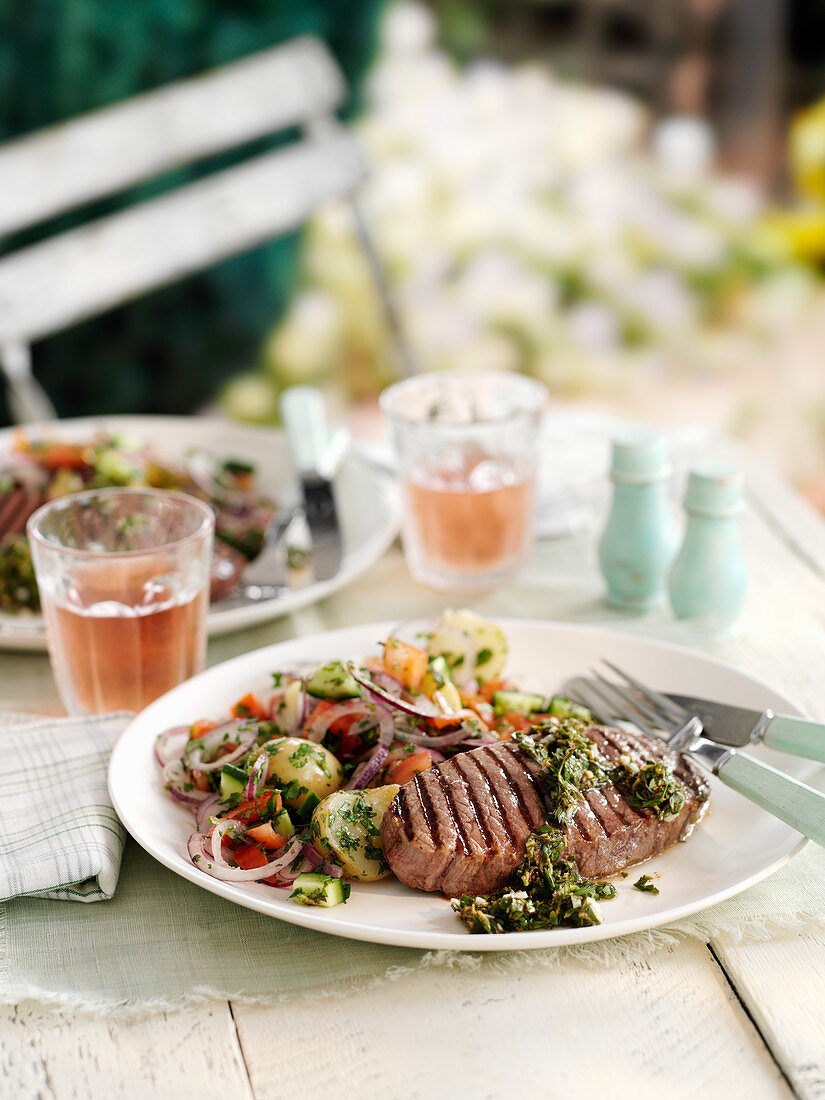 Grilled beef steaks with salmoriglio and potato salad