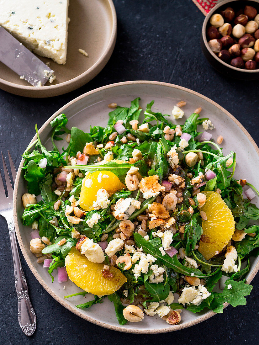 Arugula salad with oranges blue cheese and hazelnuts