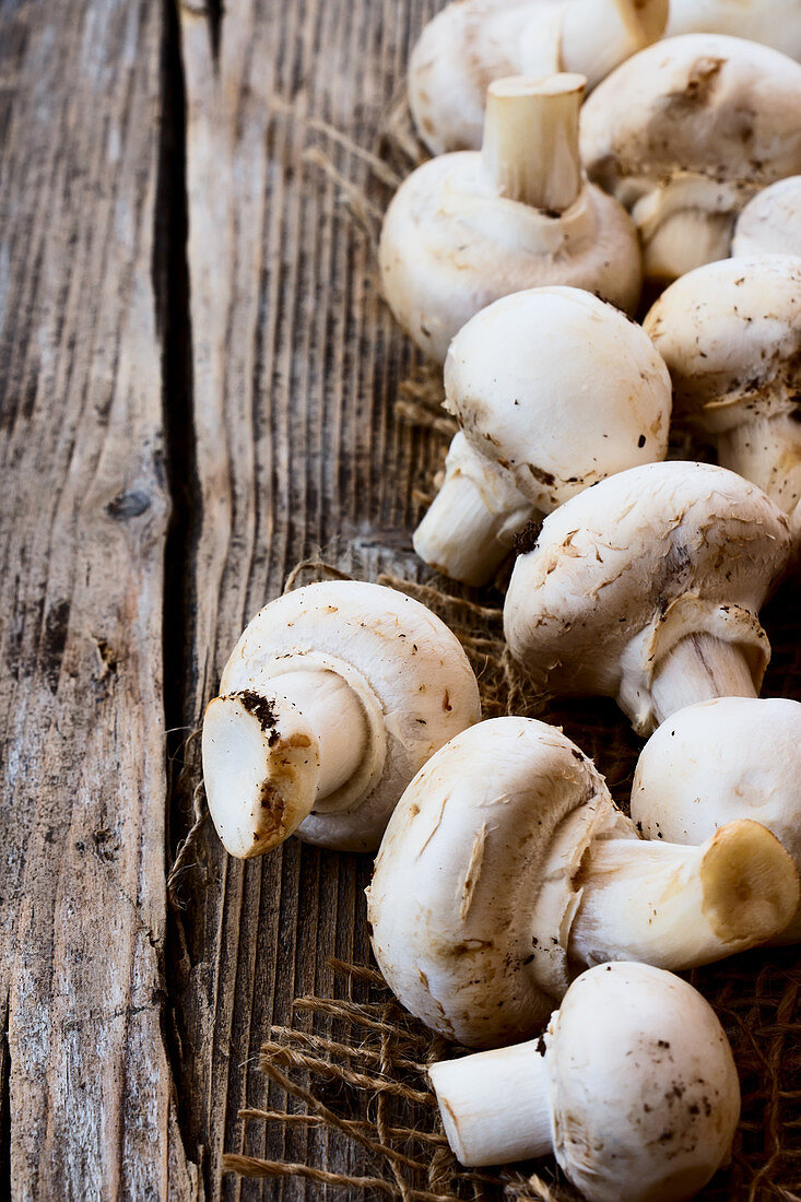 Fresh mushrooms on a wooden background