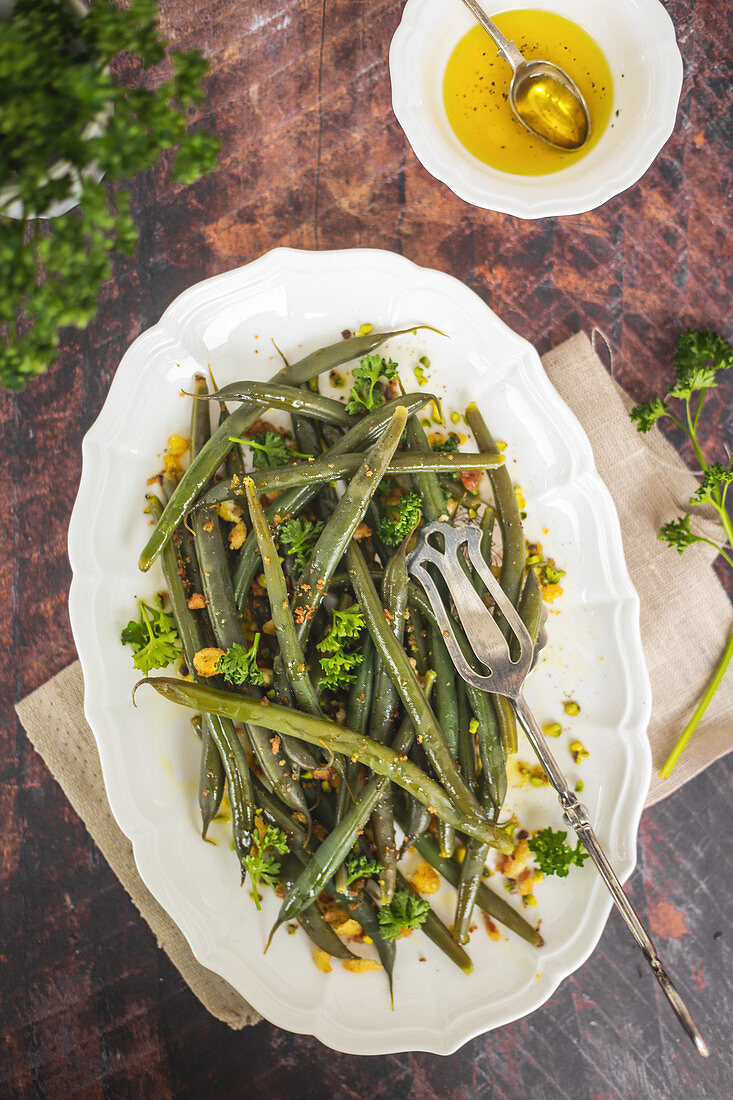 Green beans with bread crumbs oil curly parsley and pistachios
