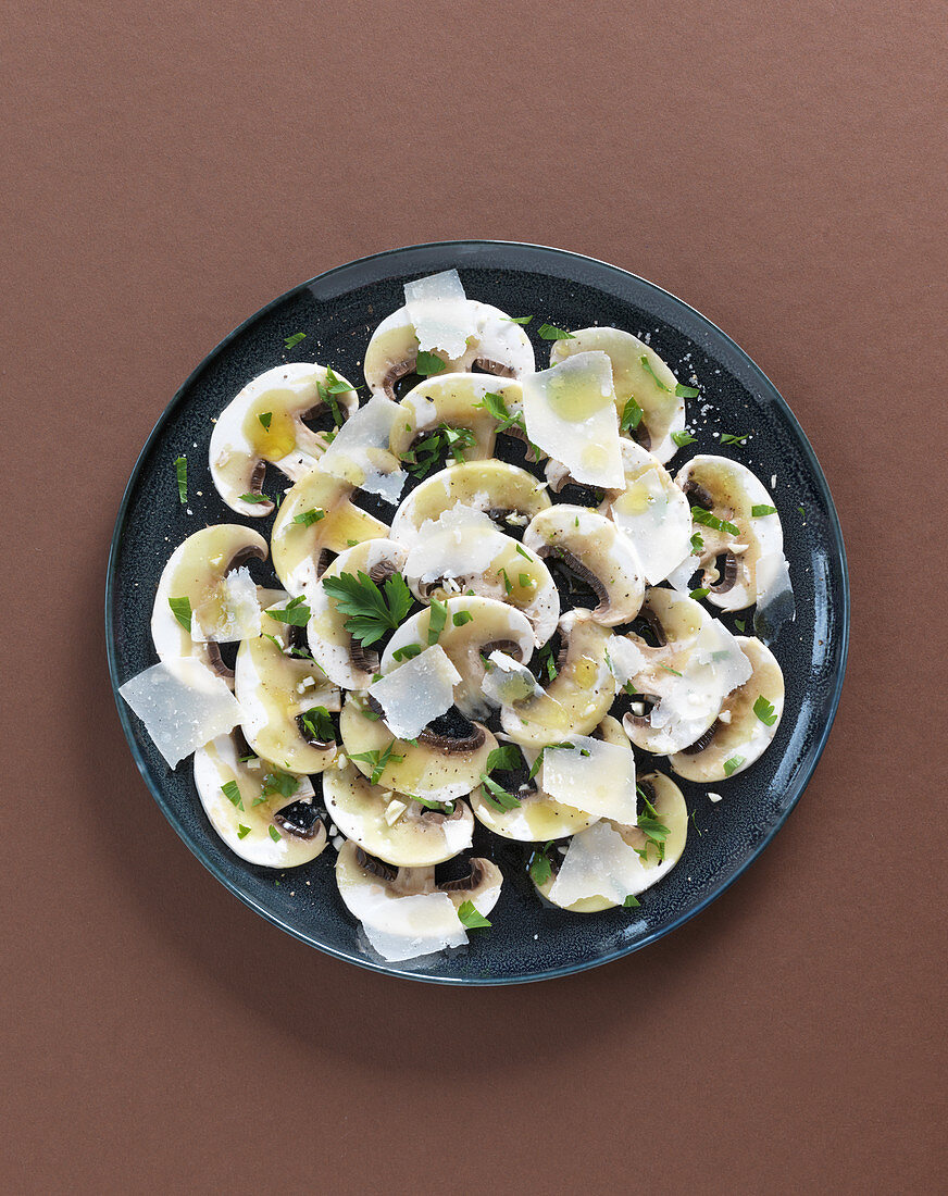 Mushroom carpaccio with Parmesan cheese