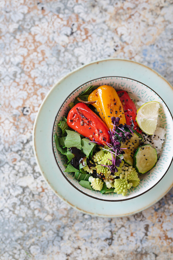 A vegan poke bowl with grilled vegetables, romanesco, sushi rice, and bok choy (Hawaii)