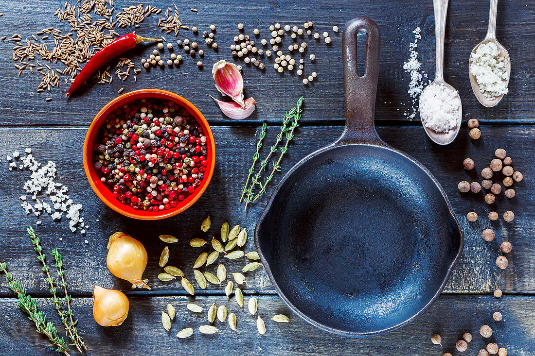 Top view of fresh herbs and spices selection over dark old wooden background