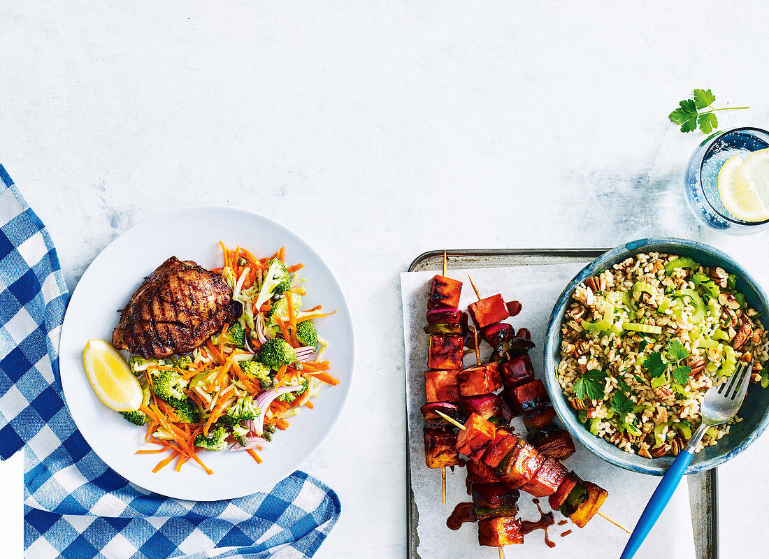 Charred cajun chicken with raw broccoli salad, ham skewers with rice and pecan salad