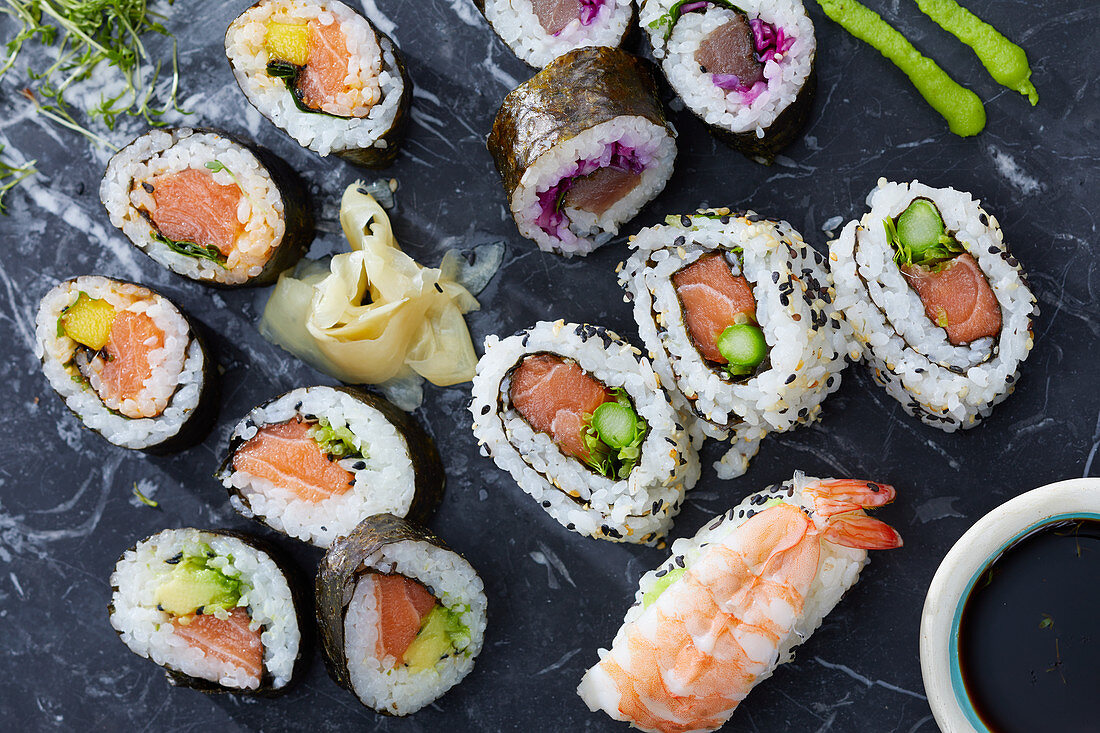 Various types of sushi: maki, California rolls and nigiri sushi (Japan)