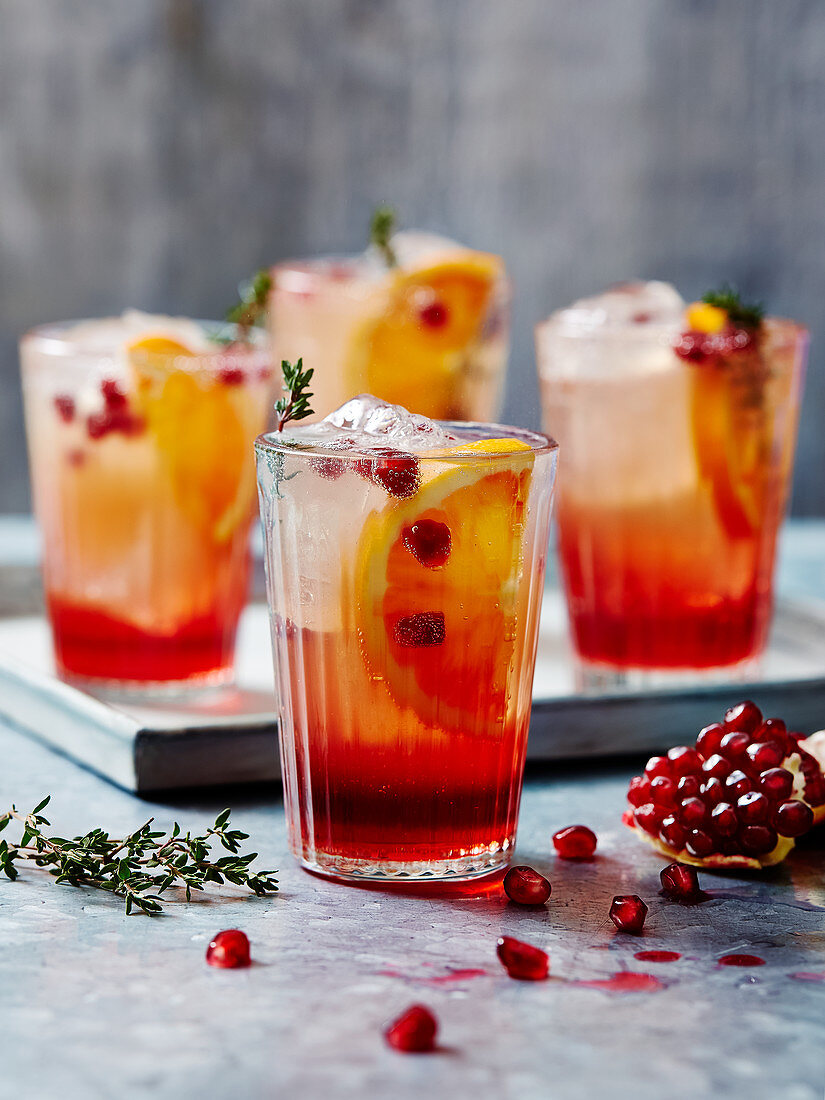 Orange and pomegranate mocktails with thyme