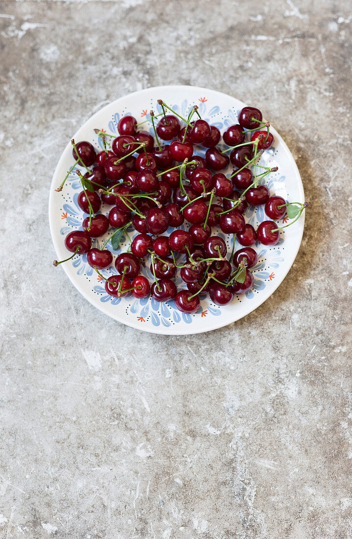 Dark red cherries on a plate