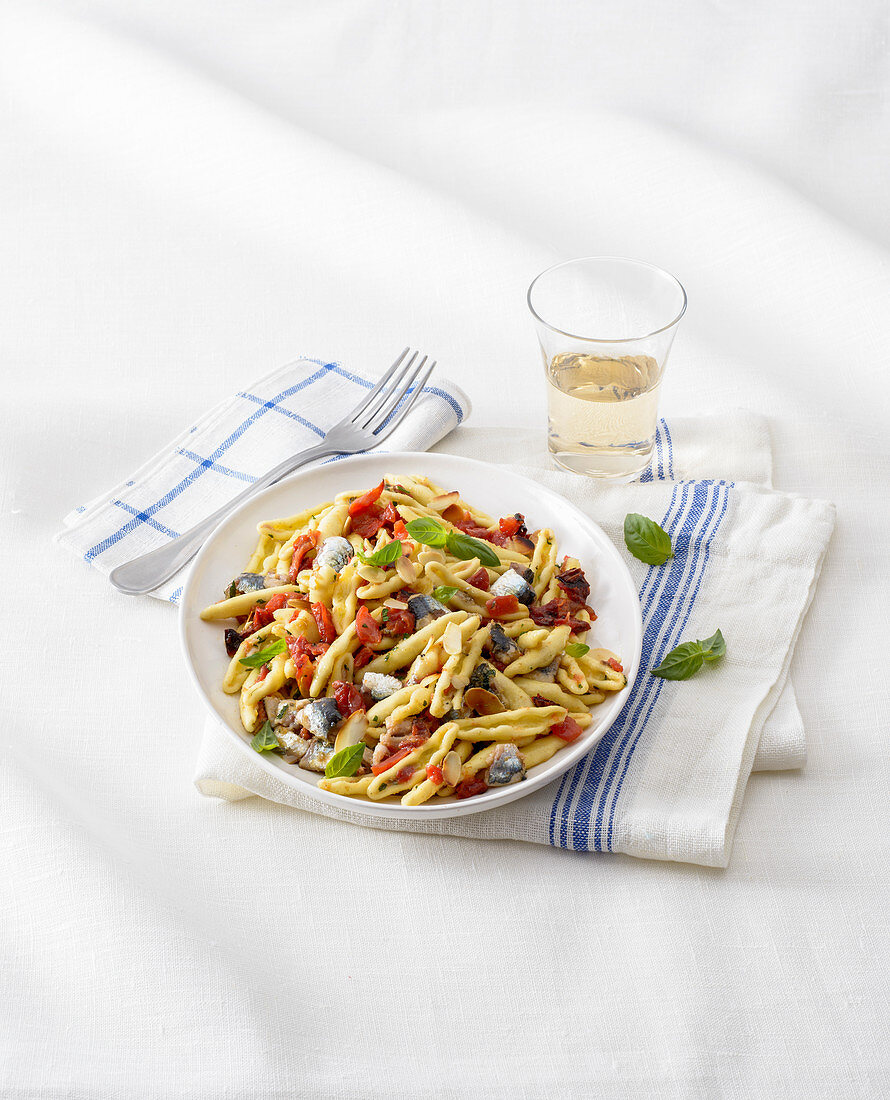 Capunti Pasta with Roasted Tomatoes, Sardines and Crispy Almonds
