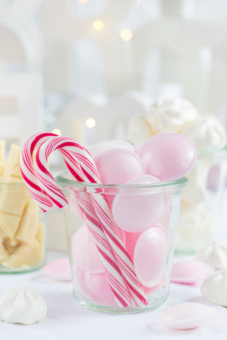 Red and white candy canes and pink sherbet UFOs