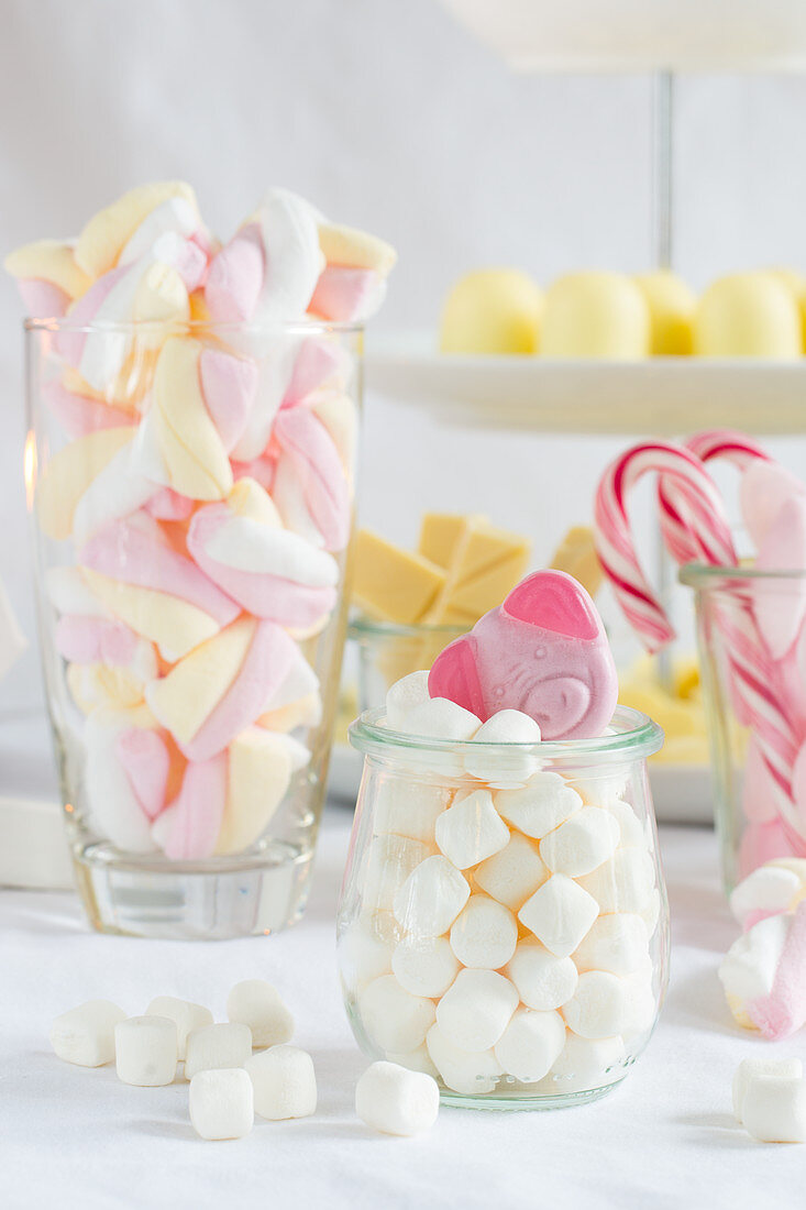 Two jars of marshmallows and a gummy pig sweet