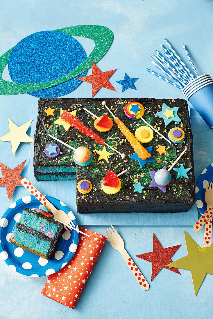 A galaxy cake decorated with stars